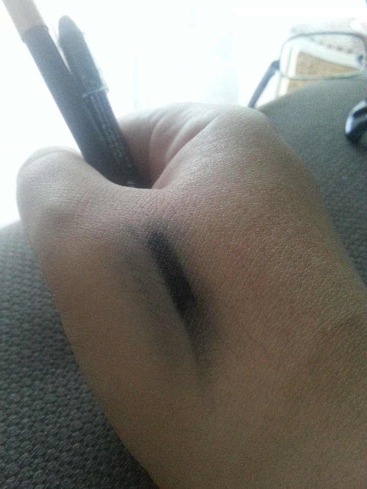 Napoleon liner, on left almost wiped away, while Scandaleyes smudges but totally survives - which is fine BECAUSE I DON'T INTEND ON RUBBING MY EYEBALLS.